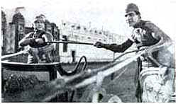 FrancisX. Bushman battles with Ramon Navarro in the chariot race finale to Ben Hur (1924)